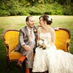 Happy couple sitting on an antique love seat