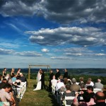 Wedding taking place outdoors overlooking a scenic river